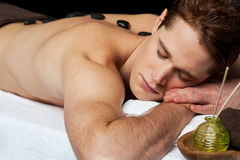Man relaxing at spa. Royalty Free Stock Photography