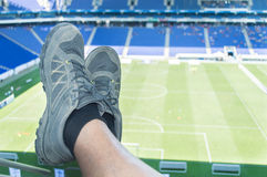 Man relaxing at the sport stadium Stock Images
