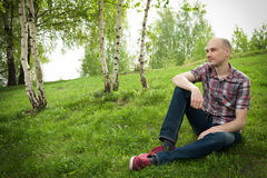 Man relaxing in summer park Stock Photography