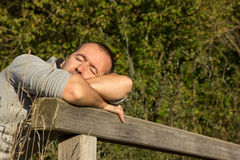 Man relaxing. On a sunny day Royalty Free Stock Image