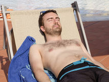 Man relaxing in a swimming pool Stock Photos