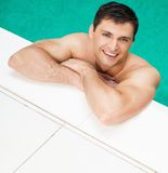Man relaxing in swimming pool Royalty Free Stock Images