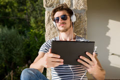 Man relaxing with tablet pc Stock Image