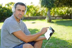Man relaxing with tablet pc Stock Photo