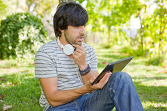 Man relaxing with tablet pc Royalty Free Stock Images