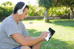 Man relaxing with tablet pc Royalty Free Stock Image