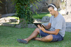 Man relaxing with tablet pc Royalty Free Stock Photo