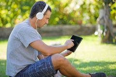 Man relaxing with tablet pc Stock Photography