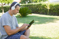 Man relaxing with tablet pc royalty free stock photos