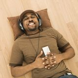 Man relaxing to music. Royalty Free Stock Photo