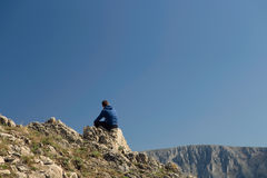 Man relaxing on top of mountain Royalty Free Stock Photography
