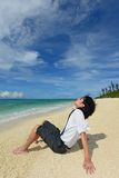 A Man Relaxing on Tropical Beach Royalty Free Stock Photography