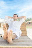 Man relaxing in tropical resort Royalty Free Stock Image
