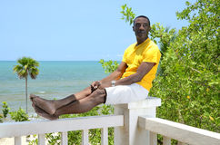 Man relaxing in the tropics Stock Photography