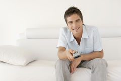 Man Relaxing Using Remote Control Royalty Free Stock Photography