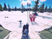 Man relaxing. Winter view from camping  tent entrance out. To snowy landscape. Travel Lifestyle concept, snow mountains. Hikers winter vacation Royalty Free Stock Photography