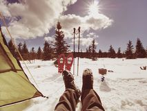 Man relaxing. Winter view from camping  tent entrance out. To snowy landscape. Travel Lifestyle concept, snow mountains. Hikers winter vacation Stock Photo