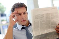Man relaxing at work Stock Photos