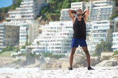 Man relaxing after work out at the beach Royalty Free Stock Photos
