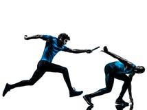 Man relay runner sprinter  silhouette. Two men relay running sprinting in silhouette studio isolated on white background Stock Photo