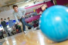Man releasing bowling ball. Man Stock Photography