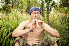 Man with relish playing  the flute Royalty Free Stock Photos
