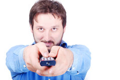 Man with remote control. Smiling young man with remote control in hands Stock Image