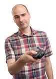 Man with remote control Royalty Free Stock Photos