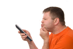 Man with Remote Control. A young man has trouble finding something worth watching on TV Royalty Free Stock Photos