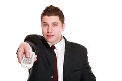 Man with remote control changing channel Royalty Free Stock Image