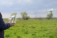 A man with a remote control in his hands. Flight control of the drone. Phantom.  Stock Photography
