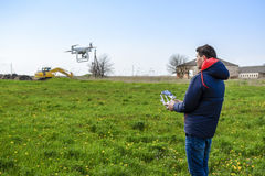 A man with a remote control in his hands. Flight control of the drone. Phantom.  Stock Images