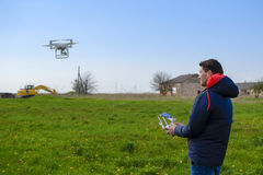 A man with a remote control in his hands. Flight control of the drone. Phantom.  Stock Photos