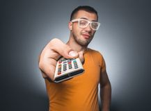 Man with remote control Stock Photo