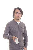 Man with remote control isolated on white Stock Photo
