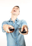 Man with a remote control Stock Image