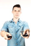 Man with a remote control Royalty Free Stock Photography