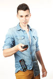 Man with a remote control Royalty Free Stock Photos