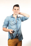 Man with a remote control Royalty Free Stock Images