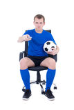 Man with remote control watching soccer game isolated on white Royalty Free Stock Image