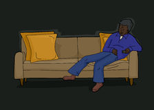 Man with Remote on Sofa. Tired man laying down on sofa with remove control Royalty Free Stock Images