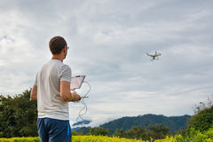 Man with remout controling drone DJI Phantom 4 in Phuket Stock Image