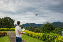 Man with remout controling drone DJI Phantom 4 in Phuket Royalty Free Stock Image