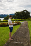 Man with remout controling drone DJI Phantom 4 in Phuket. Thailand Royalty Free Stock Images