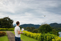 Man with remout controling drone DJI Phantom 4 in Phuket. Thailand Royalty Free Stock Photos