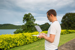 Man with remout controling drone DJI Phantom 4 in Phuket. Thailand Stock Photography