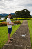 Man with remout controling drone DJI Phantom 4 in Phuket. Thailand Stock Images