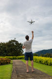 Man with remout controling drone DJI Phantom 4 in Phuket Stock Images