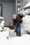 Man is removal snow Royalty Free Stock Images