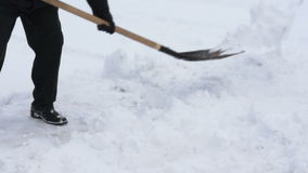 A man removes snow stock footage